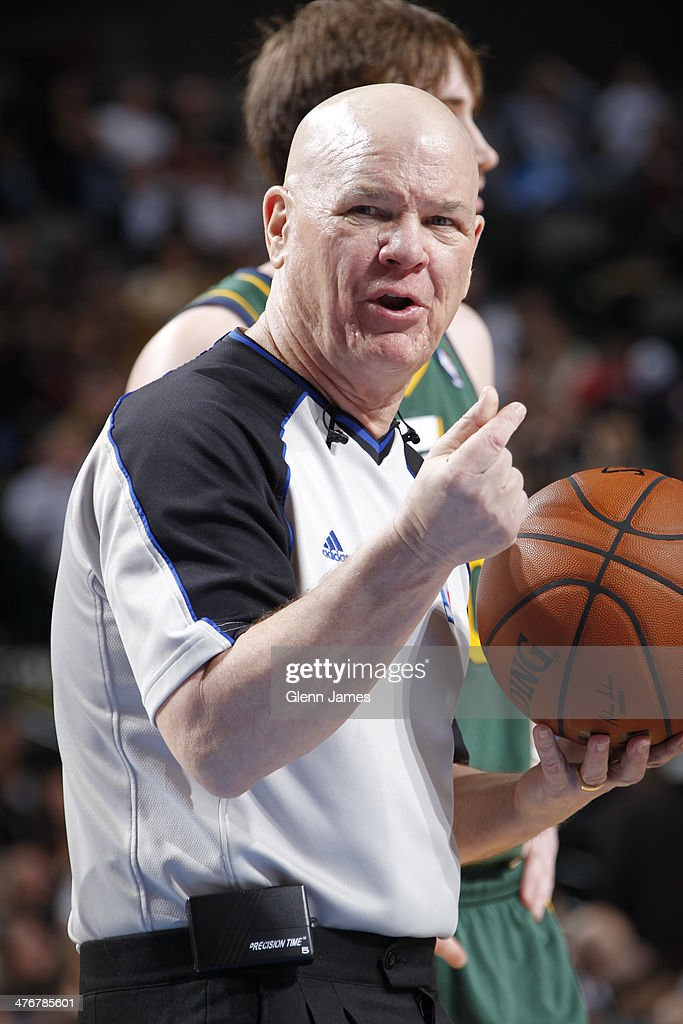 Referee Joey Crawford makes a call during the Dallas Mavericks game against the Utah Jazz on February 7, 2014 at the American Airlines Center in Dallas, Texas.