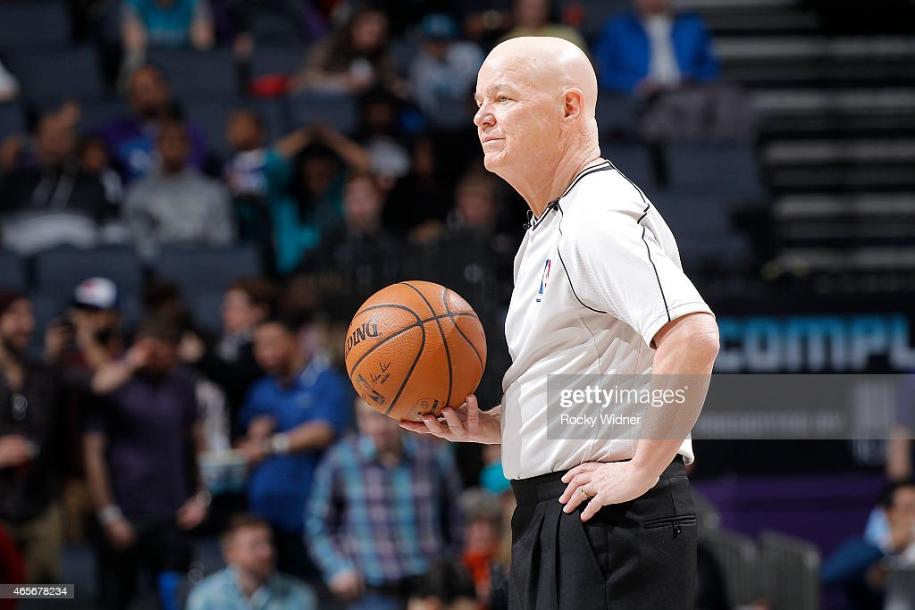 NBA referee <a gi-track='captionPersonalityLinkClicked' href=/galleries/search?phrase=Joey+Crawford&family=editorial&specificpeople=559119 ng-click='$event.stopPropagation()'>Joey Crawford</a> officiates the game between the Toronto Raptors and Charlotte Hornets on March 6, 2015 at Time Warner Cable Arena in Charlotte, North Carolina.