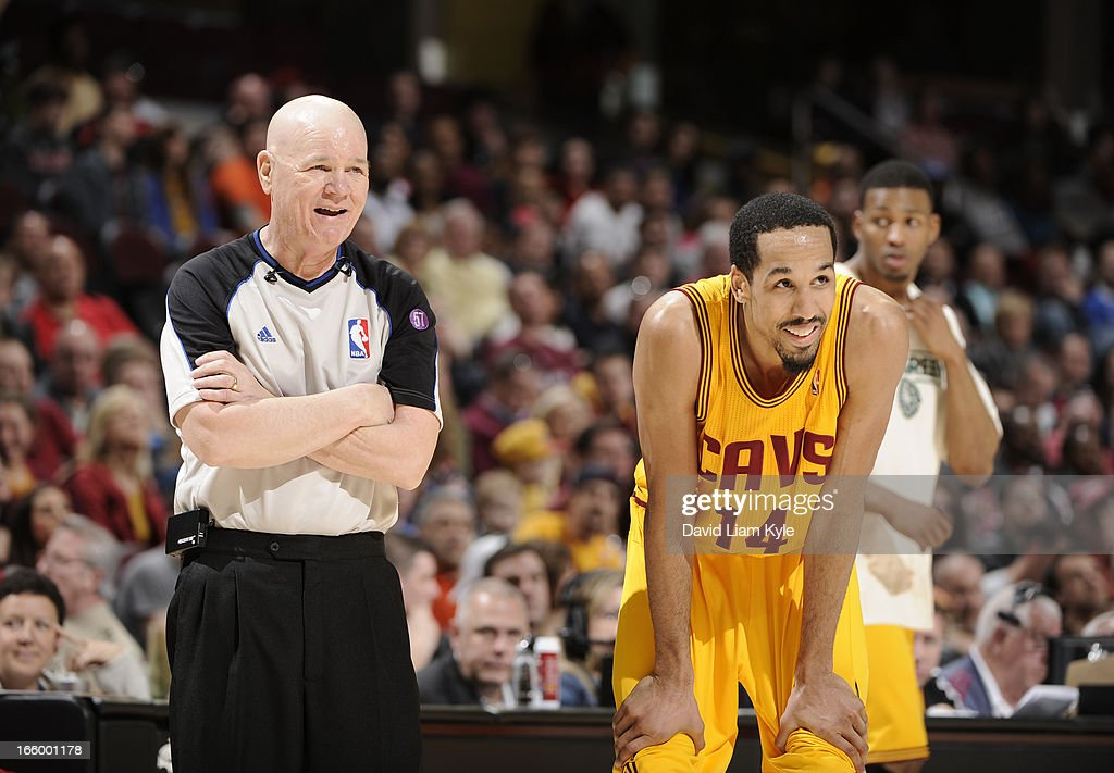 Referee Joey Crawford #17 shares a laugh with Shaun Livingston #14 of the Cleveland Cavaliers during a break in the action against the Orlando Magic at The Quicken Loans Arena on April 7, 2013 in Cleveland, Ohio.