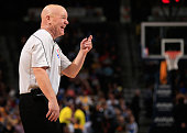 Referee Joey Crawford shares a lighter moment as he oversees the action between the Sacramento Kings and the Denver Nuggets at Pepsi Center on...