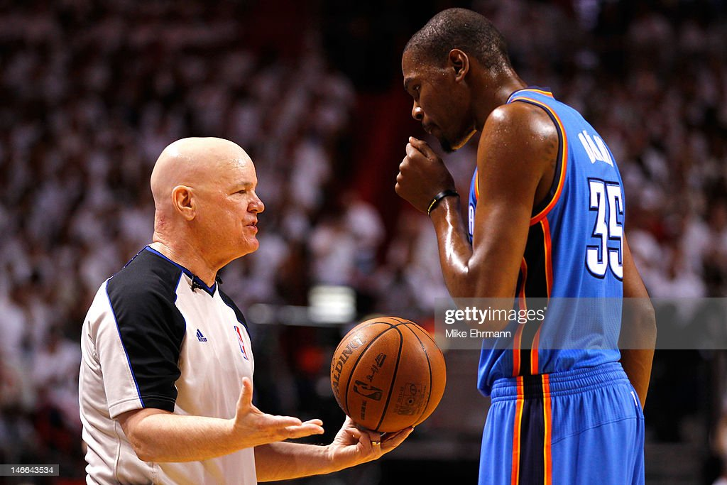 Referee Joey Crawford #17 talkes with Kevin Durant #35 of the Oklahoma City Thunder on court against the Miami Heat in Game Three of the 2012 NBA Finals on June 17, 2012 at American Airlines Arena in Miami, Florida.