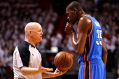 Referee Joey Crawford talkes with Kevin Durant of the Oklahoma City Thunder on court against the Miami Heat in Game Three of the 2012 NBA Finals on...