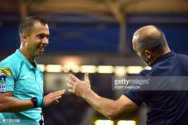 Referee Johan Hamel speaks with Toulouses' coach Pascal Dupraz during the French L1 football match Toulouse against Guingamp on September 17 2016 at...