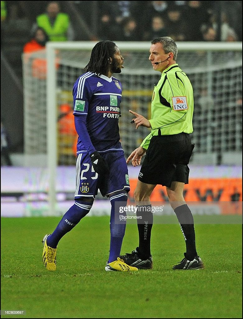 Referee Johan Verbist and Dieudonne Mbokani of RSC Anderlecht in action during the Jupiler League match between RSC Anderlecht and SV Zulte Waregem on February 27, 2013 in Anderlecht, Belgium.