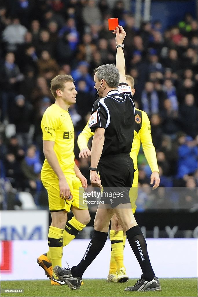 Referee Johan Verbist shows a red card to Laurens De Bock of Club Brugge KV during the Jupiler League match between KRC Genk and Club Brugge KV on February 3, 2013 in Genk, Belgium.