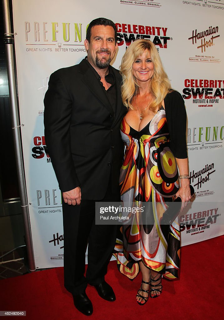 Referee John McCarthy (L) and his wife Elaine McCarthy (R) attend Evander Holyfield's ESPYS Awards after party on July 16, 2014 in Los Angeles, California.