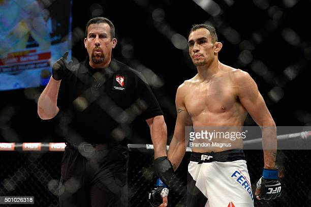 Referee John McCarthy deducts a point from Tony Ferguson for an illegal kick against Edson Barboza in their lightweight bout during the TUF Finale...