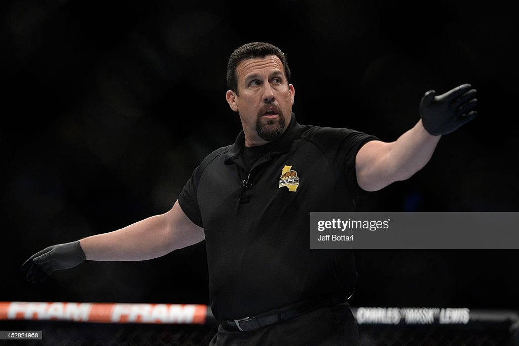 Referee John McCarthy signals the start of round four between Robbie Lawler and Matt Brown in their welterweight bout during the UFC Fight Night event at the SAP Center on July 26, 2014 in San Jose, California.