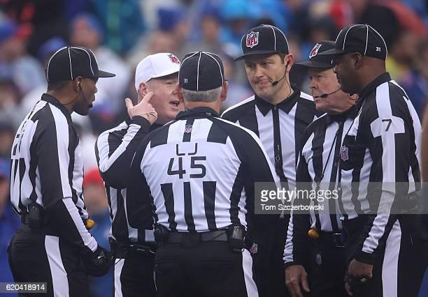 Referee John Parry and field judge Jabir Walker and line judge Jeff Seeman and umpire Mark Pellis and head linesman John McGrath and side judge Keith...