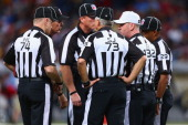 Referee John Parry holds a meeting with other officials during a game between the St Louis Rams and the Tampa Bay Buccaneers at the Edward Jones Dome...