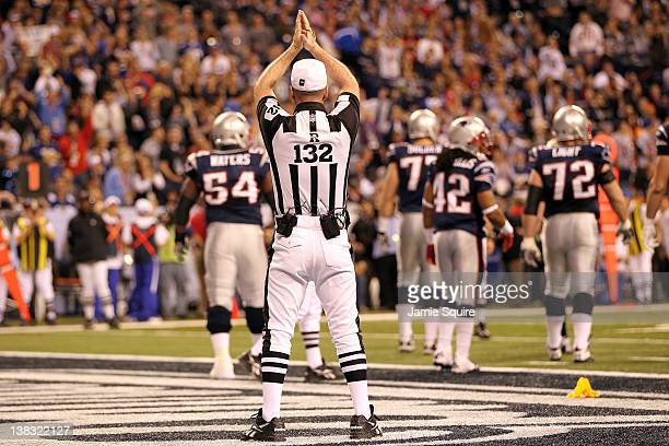Referee John Parry signals a safety after an intentional grounding call against Tom Brady of the New England Patriots during Super Bowl XLVI at Lucas...