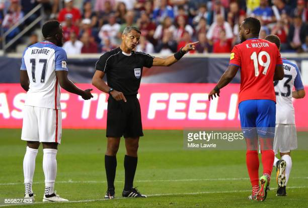 Referee John Pitti of Panama speaks to Jozy Altidore of the United States and Kendall Watson of Costa Rica during the FIFA 2018 World Cup Qualifier...