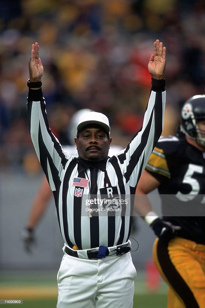 NFL referee Johnny Grier #23 signals touchdown during a game between the Detroit Lions and Pittsburgh Steelers at Heinz Field on December 23, 2001 in Pittsburgh, Pennsylvania.
