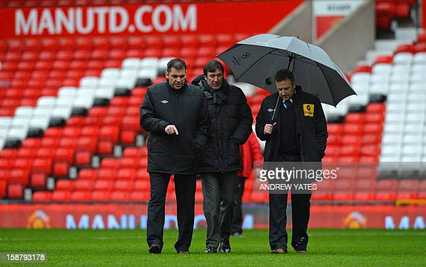 Referee Jon Moss and fourth official Phil Dowd inspect the pitch before the English Premier League football match between Manchester United and West...