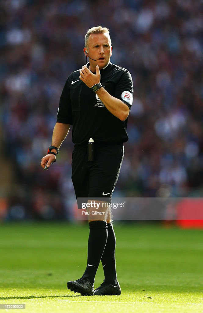 Referee Jon Moss looks on during the FA Cup Final between Aston Villa and Arsenal at Wembley Stadium on May 30, 2015 in London, England.