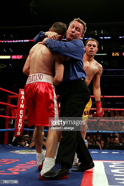 Referee Jon Schorle grabs Jesse Feliciano and stops the fight in the 10th round of the IBF Welterweight title fight against Kermit Cintron at Staples...