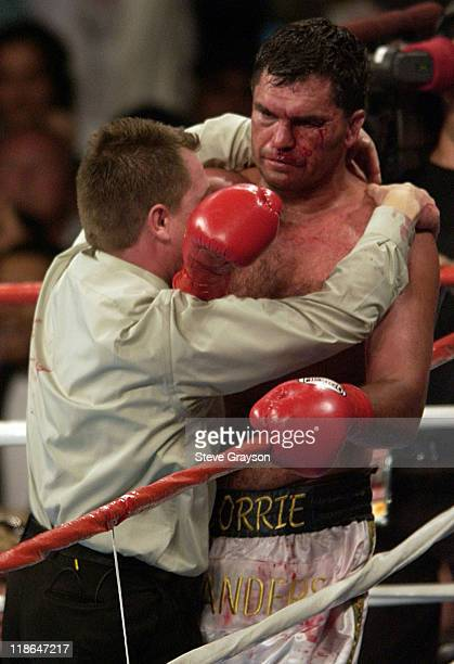 Referee Jon Schorle holds Corrie Sanders and stops the fight declaring Vitali Klitschko the winner in the 8th round of their WBC Heavyweight...