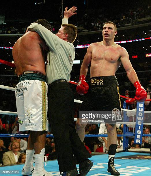 Referee Jon Schorle stops the fight as Vitali Klitschko right defeats Corrie Sanders in the 8th round to win the WBC Heavyweight title at the Staples...