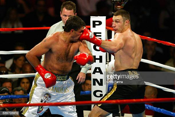 Referee Jon Schorle watches as Vitali Klitschko connects with a left during his win over Corrie Sanders by a TKO in the eighth round to win the WBC...