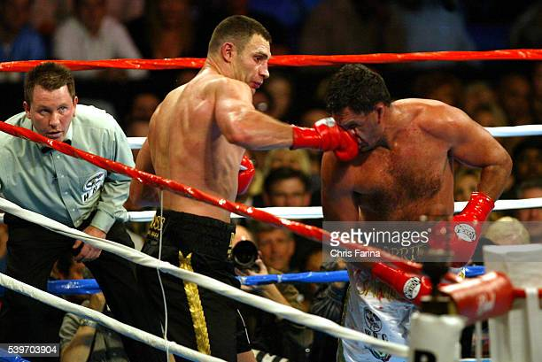 Referee Jon Schorle watches as Vitali Klitschko connects with a right during his win over Corrie Sanders by a TKO in the eighth round to win the WBC...