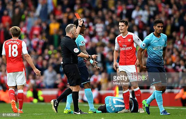 Referee Jonanthan Moss shows Granit Xhaka of Arsenal a red card during the Premier League match between Arsenal and Swansea City at Emirates Stadium...