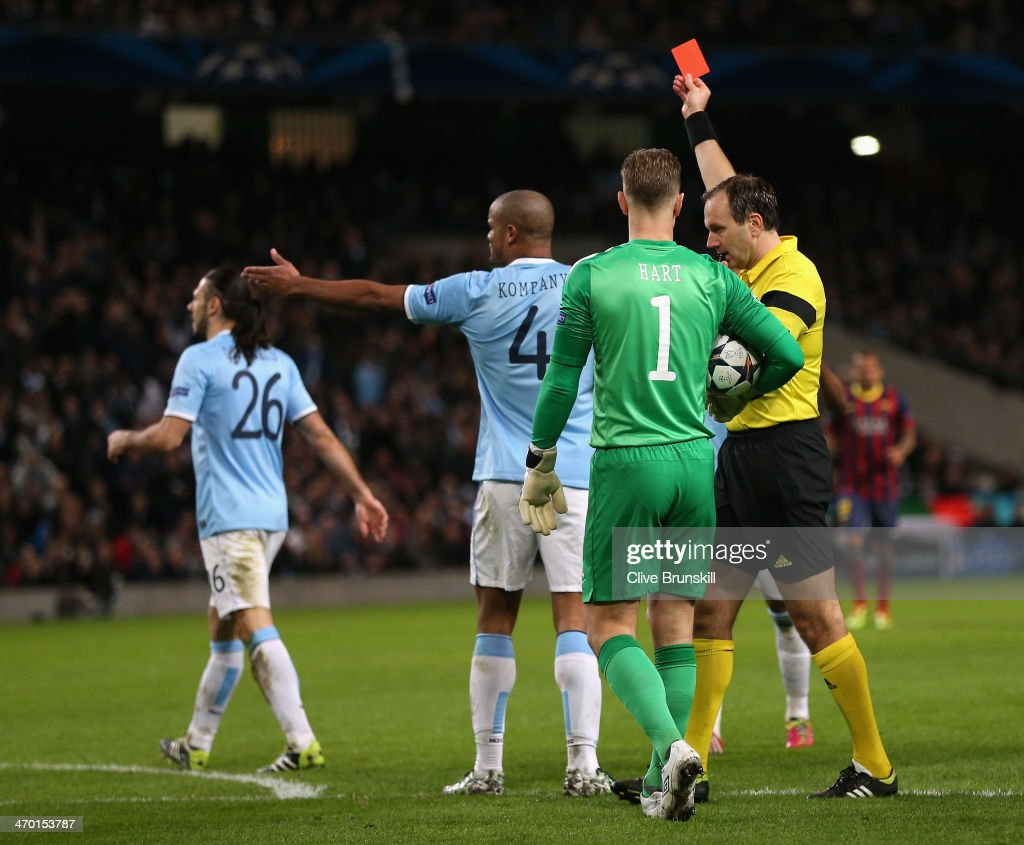 Referee Jonas Eriksson shows a red card to <a gi-track='captionPersonalityLinkClicked' href=/galleries/search?phrase=Martin+Demichelis&family=editorial&specificpeople=240330 ng-click='$event.stopPropagation()'>Martin Demichelis</a> of Manchester City during the UEFA Champions League Round of 16 first leg match between Manchester City and Barcelona at the Etihad Stadium on February 18, 2014 in Manchester, England.