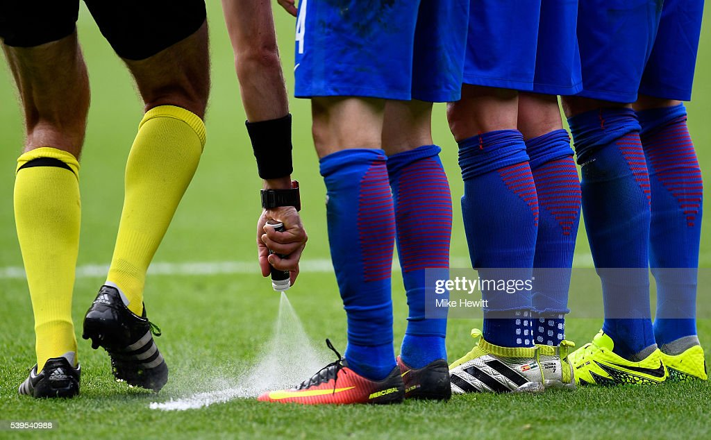 Referee <a gi-track='captionPersonalityLinkClicked' href=/galleries/search?phrase=Jonas+Eriksson+-+Referee&family=editorial&specificpeople=12731953 ng-click='$event.stopPropagation()'>Jonas Eriksson</a> uses the vanishing spray during the UEFA EURO 2016 Group D match between Turkey and Croatia at Parc des Princes on June 12, 2016 in Paris, France.