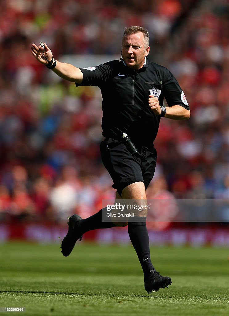 Referee <a gi-track='captionPersonalityLinkClicked' href=/galleries/search?phrase=Jonathan+Moss+-+Soccer+Referee&family=editorial&specificpeople=14630509 ng-click='$event.stopPropagation()'>Jonathan Moss</a> in action during the Barclays Premier League match between Manchester United and Tottenham Hotspur at Old Trafford on August 8, 2015 in Manchester, England.