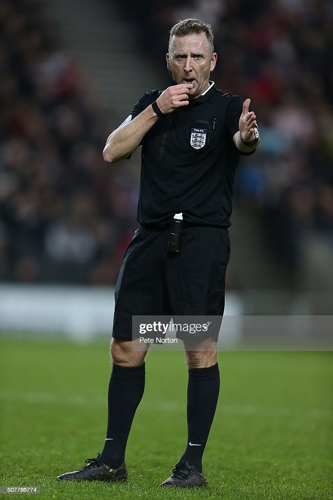 Referee <a gi-track='captionPersonalityLinkClicked' href=/galleries/search?phrase=Jonathan+Moss+-+Soccer+Referee&family=editorial&specificpeople=14630509 ng-click='$event.stopPropagation()'>Jonathan Moss</a> in action during The Emirates FA Cup Fourth Round match between Milton Keynes Dons and Chelsea at Stadium mk on January 31, 2016 in Milton Keynes, England.