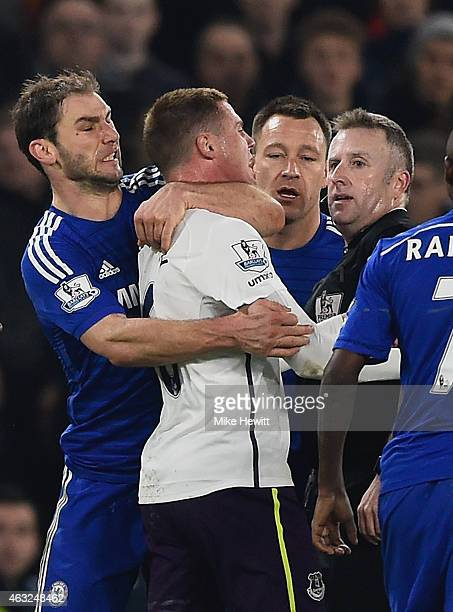 Referee Jonathan Moss looks on as Branislav Ivanovic of Chelsea clashes with James McCarthy of Everton during the Barclays Premier League match...