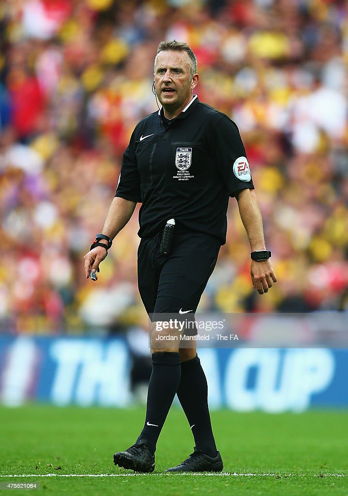 Referee <a gi-track='captionPersonalityLinkClicked' href=/galleries/search?phrase=Jonathan+Moss+-+Soccer+Referee&family=editorial&specificpeople=14630509 ng-click='$event.stopPropagation()'>Jonathan Moss</a> looks on during the FA Cup Final between Aston Villa and Arsenal at Wembley Stadium on May 30, 2015 in London, England.