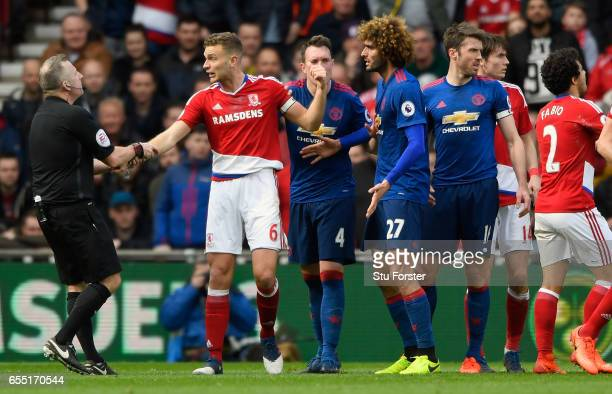 Referee Jonathan Moss pulls Middlesbrough player Ben Gibson away from trouble during the Premier League match between Middlesbrough and Manchester...