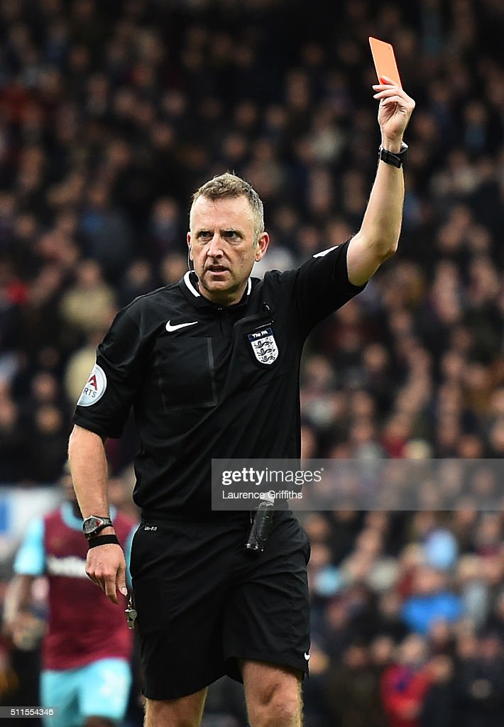 Referee <a gi-track='captionPersonalityLinkClicked' href=/galleries/search?phrase=Jonathan+Moss+-+Arbitro+di+calcio&family=editorial&specificpeople=14630509 ng-click='$event.stopPropagation()'>Jonathan Moss</a> shows the red card to Cheikhou Kouyate of West Ham United during The Emirates FA Cup fifth round match between Blackburn Rovers and West Ham United at Ewood park on February 21, 2016 in Blackburn, England.