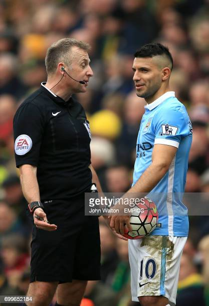 Referee Jonathan Moss speaks with Manchester City's Sergio Aguero