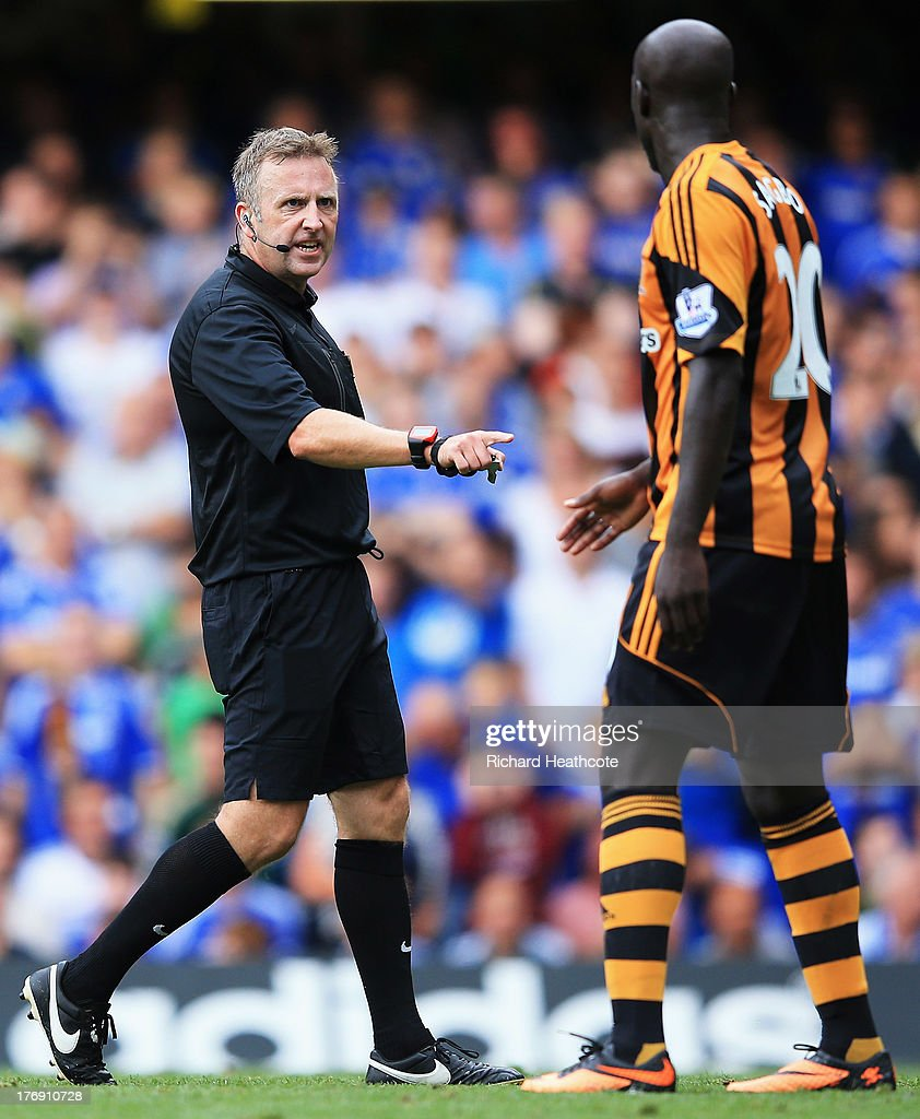 Referee Jonathan Moss talks to <a gi-track='captionPersonalityLinkClicked' href=/galleries/search?phrase=Yannick+Sagbo&family=editorial&specificpeople=6130628 ng-click='$event.stopPropagation()'>Yannick Sagbo</a> of Hull City during the Barclays Premier League match between Chelsea and Hull City at Stamford Bridge on August 18, 2013 in London, England.