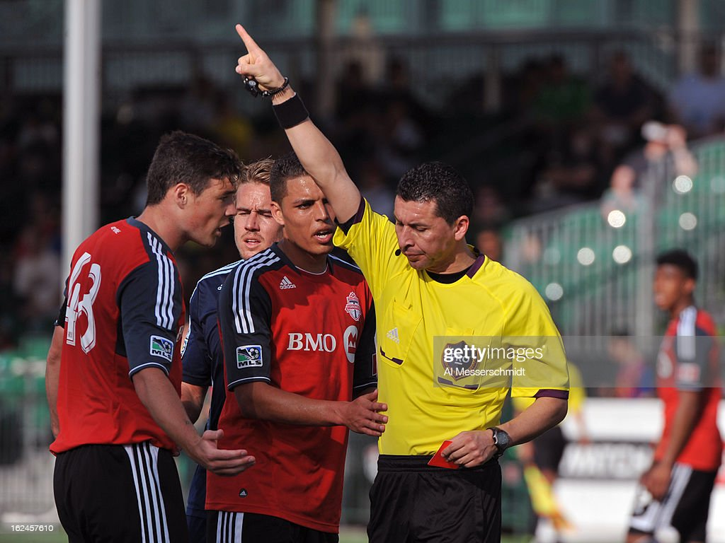 Referee Jorge Gonzalez ejects defender Darren O'Dea #48 of Toronto FC during play against Sporting Kansas City in the final round of the Disney Pro Soccer Classic on February 23, 2013 at the ESPN Wide World of Sports Complex in Orlando, Florida.