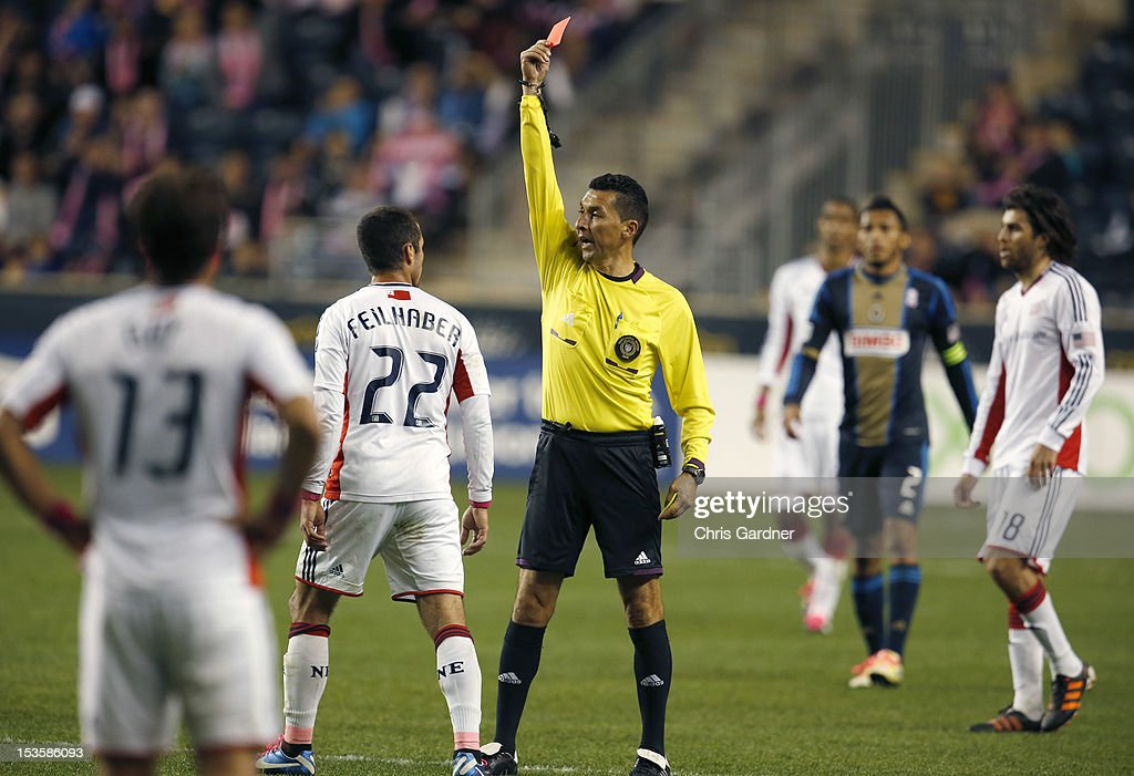 Referee Jorge Gonzalez gives a red card to <a gi-track='captionPersonalityLinkClicked' href=/galleries/search?phrase=Benny+Feilhaber&family=editorial&specificpeople=737043 ng-click='$event.stopPropagation()'>Benny Feilhaber</a> of the New England Revolution during their game against the Philadelphia Union at PPL Park on October 6, 2012 in Chester, Pennsylvania.