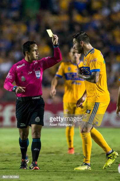 Referee Jorge Rojas gives a yellow card to AndrePierre Gignac of Tigres during the 14th round match between Tigres UANL and Toluca as part of the...