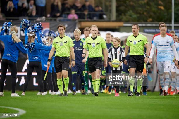Referee Jorgen Daugbjerg Burchardt and linesmen walk on to the pitch prior to the Danish Alka Superliga match between FC Helsingor and Brondby IF at...