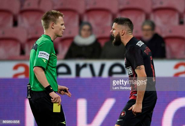 Referee Jorgen Daugbjerg Burchardt and Marc Dal Hende of FC Midtjylland $discussing during the Danish Alka Superliga match between FC Midtjylland and...