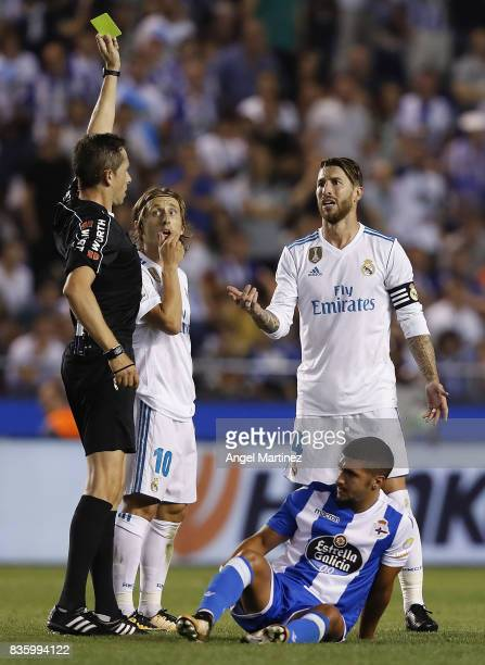 Referee Jose Luis Gonzalez shows a yellow card to Sergio Ramos of Real Madrid during the La Liga match between Deportivo La Coruna and Real Madrid CF...