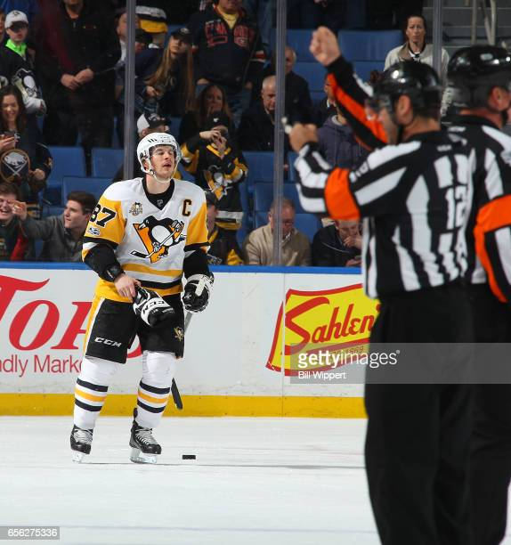 Referee Justin St Pierre signals a penalty as Sidney Crosby of the Pittsburgh Penguins skates off the ice after being highsticked in the mouth late...