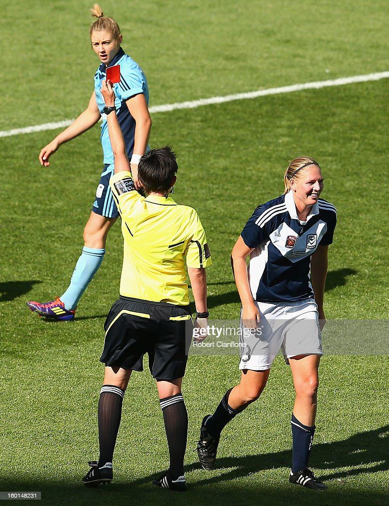 Referee Kate Jacewicz sends off Maika Ruyter-Hooley of the Victory during the W-League Grand Final between the Melbourne Victory and Sydney FC at AAMI Park on January 27, 2013 in Melbourne, Australia.