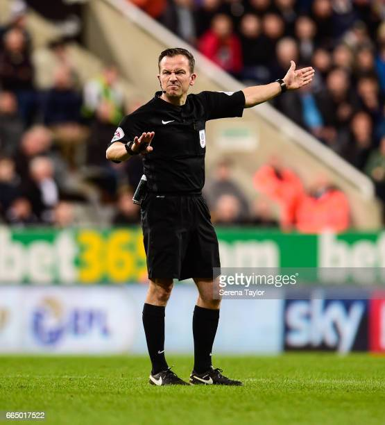Referee Keith Stroud points for a free kick during the Sky Bet Championship Match between Newcastle United and Burton Albion at StJames' Park on...