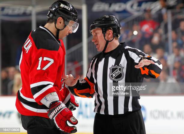 Referee Kelly Sutherland chats with Ilya Kovalchuk of the New Jersey Devils during the game against the New York Rangers at the Prudential Center on...