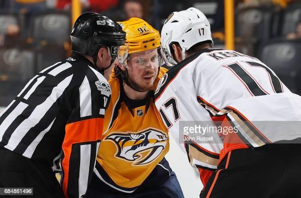 Referee Kelly Sutherland into a conversation between Ryan Johansen of the Nashville Predators and Ryan Kesler of the Anaheim Ducks before a faceoff...