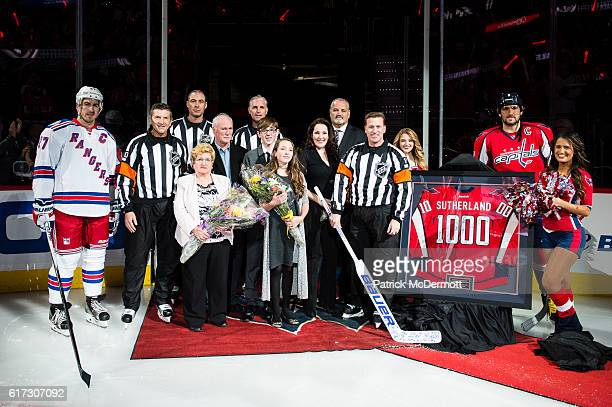 Referee Kelly Sutherland is recognized during a pregame ceremony to honor his 1000th career NHL game prior to a game between the New York Rangers and...