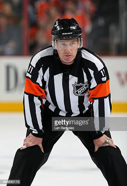 Referee Kelly Sutherland looks on during a game between the Philadelphia Flyers and the New York Rangers on October 24 2015 at the Wells Fargo Center...