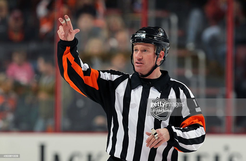 Referee <a gi-track='captionPersonalityLinkClicked' href=/galleries/search?phrase=Kelly+Sutherland&family=editorial&specificpeople=804878 ng-click='$event.stopPropagation()'>Kelly Sutherland</a> #11 makes a gesture during a NHL game between the Philadelphia Flyers and the Edmonton Oilers on November 9, 2013 at the Wells Fargo Center in Philadelphia, Pennsylvania.