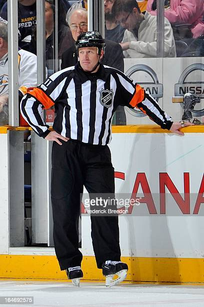 Referee Kelly Sutherland officiates a game between the Nashville Predators and the Edmonton Oilers at the Bridgestone Arena on March 25 2013 in...